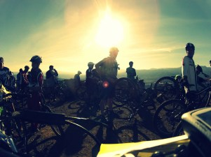 Riders assembling in the morning light to begin the first run down.