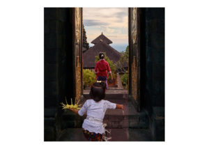 Young girls exiting Besaki temple Bali Fine Art Print