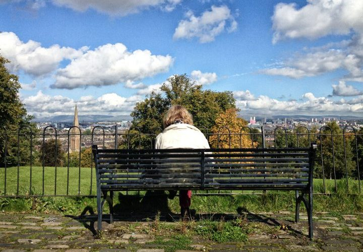 Woman reading on bench, Queen's Park, Glasgow