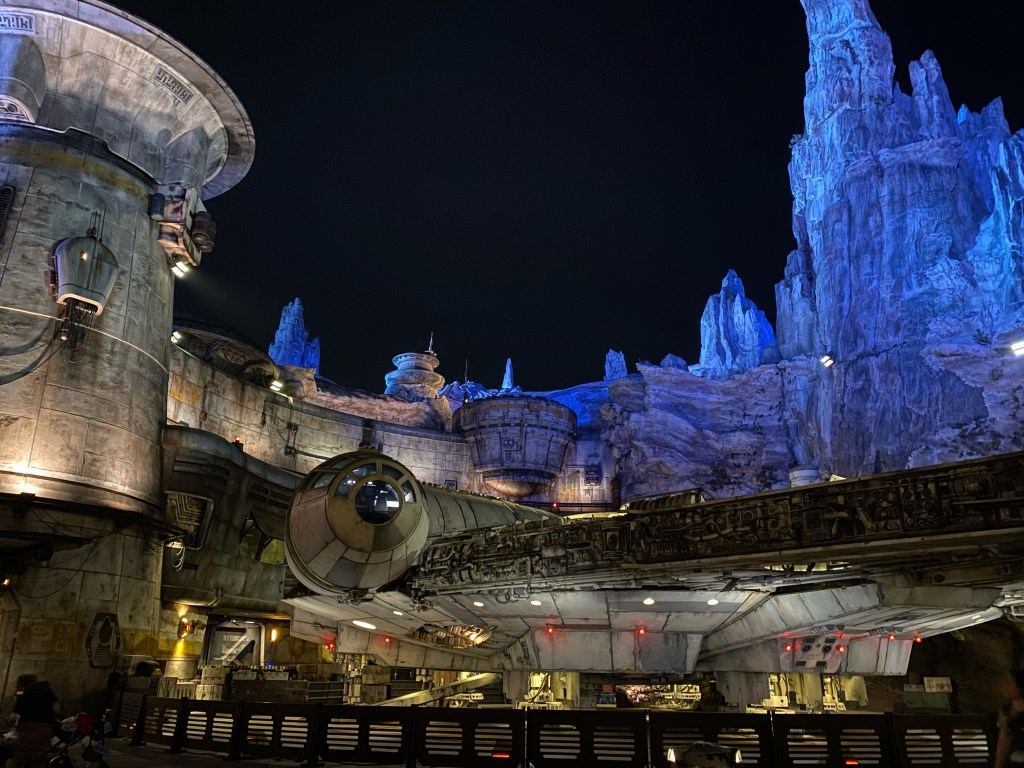 A photograph of the Millennium Falcon at Star Wars: Galaxy's Edge at night