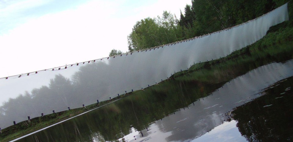 The Mist is a 45 x 6 meter collaborative eco-art installation, stretched across Mekoos Lake in Quebec.