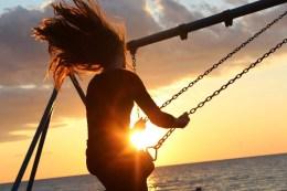 woman on swing set at ocea