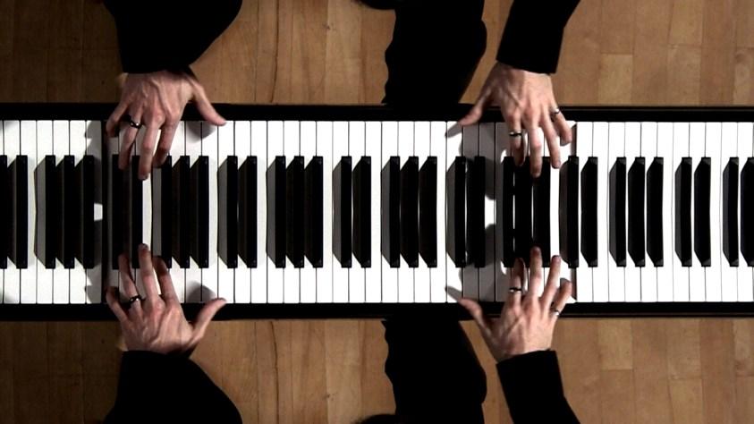 mirrors mirror image of piano hands keyboard nathan shirley