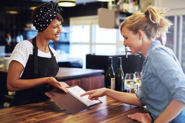 Female customer choosing wine in a bar