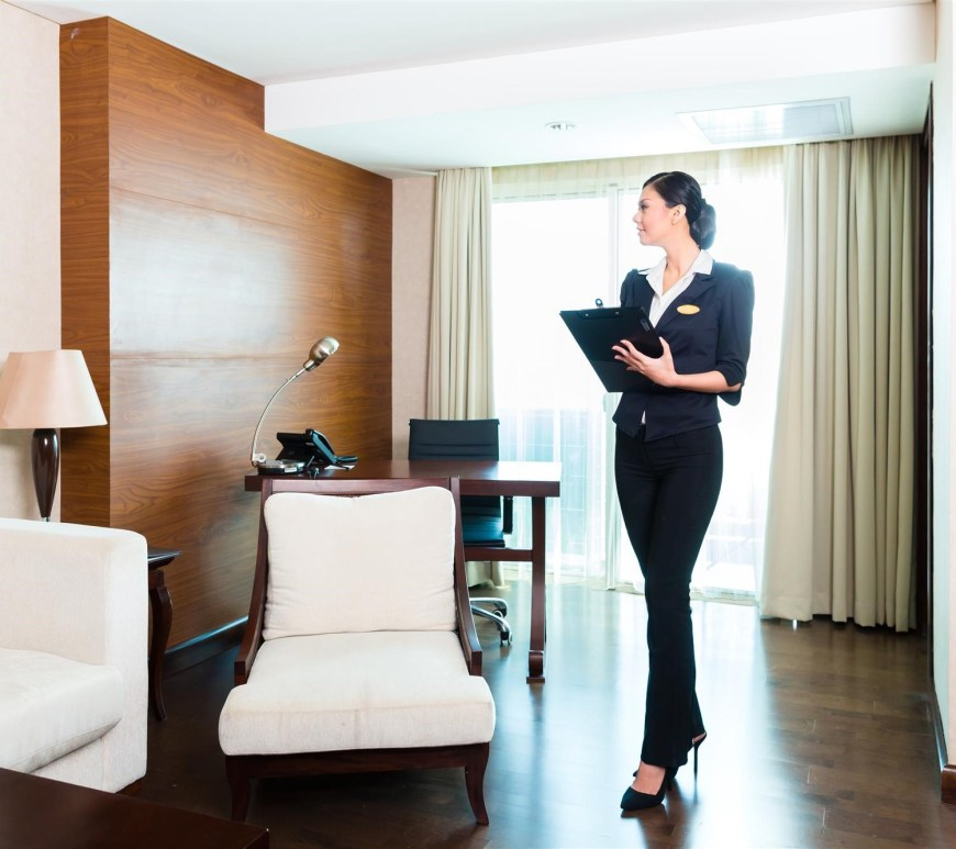 woman inventorying hotel furniture