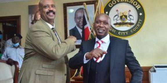 Acting Nairobi GovernorBenson Muturais congratulated by NMS Director Mohamed Badi
