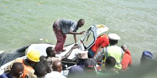Rescuers retrieve a car from the ocean in Mombasa