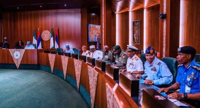 President Buhari in a meeting with service chiefs at State House, Abuja.