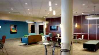 Carpet lobby area with chairs.