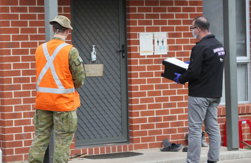 ADF personnel and a Victorian Department of Human Services door knock in Melbourne on Saturday. Source: AAP
