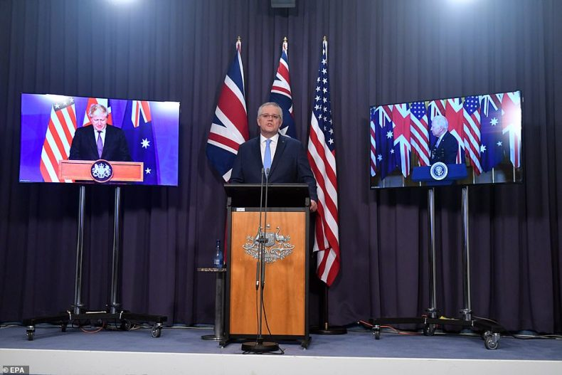 President Biden announced the deal on Wednesday night in a joint press conference with Britain's Prime Minister Boris Johnson and Australia's Prime Minister Scott Morrison (C)