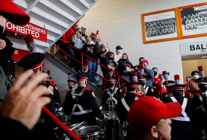 Ohio State Buckeyes fans listen as the Ohio State University Marching Band drumlins plays as they enter St. John Arena for Skull Session before a NCAA Division I football game between the Ohio State Buckeyes and the Akron Zips on Saturday, Sept. 25, 2021 at Ohio Stadium in Columbus, Ohio.