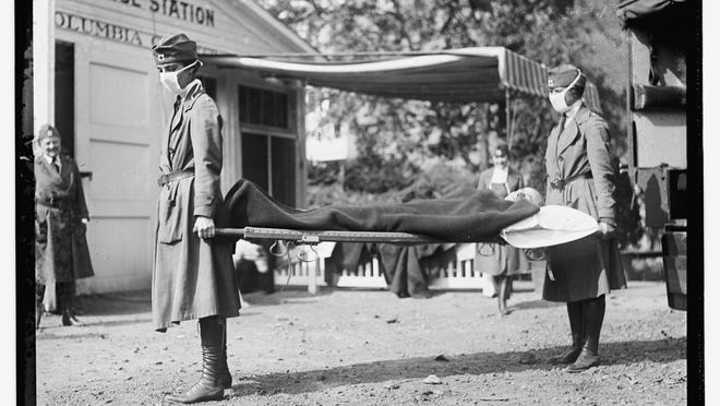This Library of Congress photo shows a demonstration at the Red Cross Emergency Ambulance Station in Washington, D.C., during the influenza pandemic of 1918. Science has ticked off some major accomplishments over the last century. The world learned about viruses, cured various diseases, made effective vaccines, developed instant communications and created elaborate public-health networks. Yet in many ways, 2020 is looking like 1918, the year the great influenza pandemic raged. (Library of Congress Prints and Photographs Division via AP)