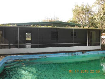 Unsecured, dirty pool and obstructed gutters at a Deutsche Bank property in Orlando