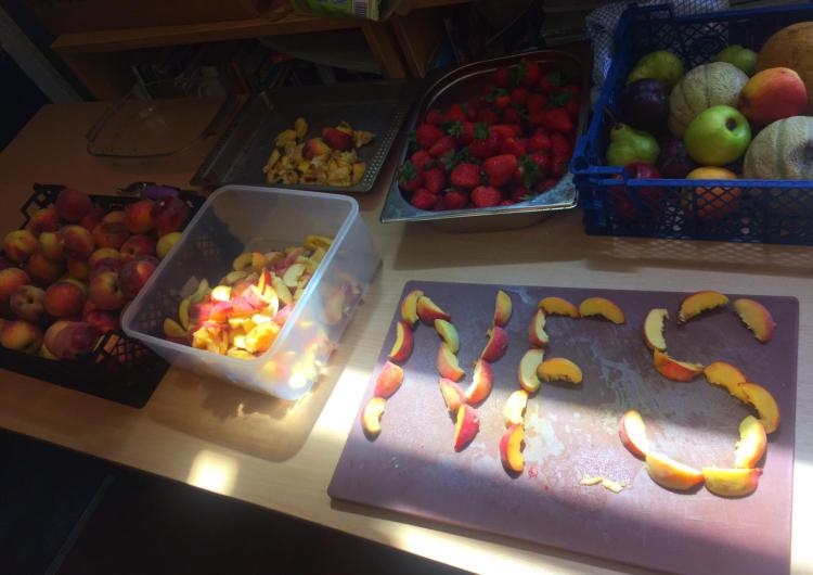 The letters NFS spelled out in cliced peaches