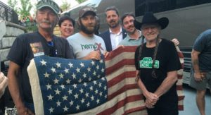 Willie Nelson (right) greets hemp advocates at the NHA 5/25 event in Asheville, NC. Pictured right to left: Willie Nelson, Jason Amatucci of the Virginia Industrial Hemp Coalition, Mike Bowman, NHA Board Chair, and local hemp supporters.