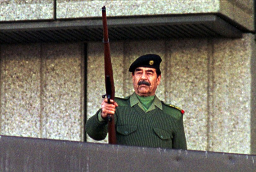 Image result for saddam hussein with gun