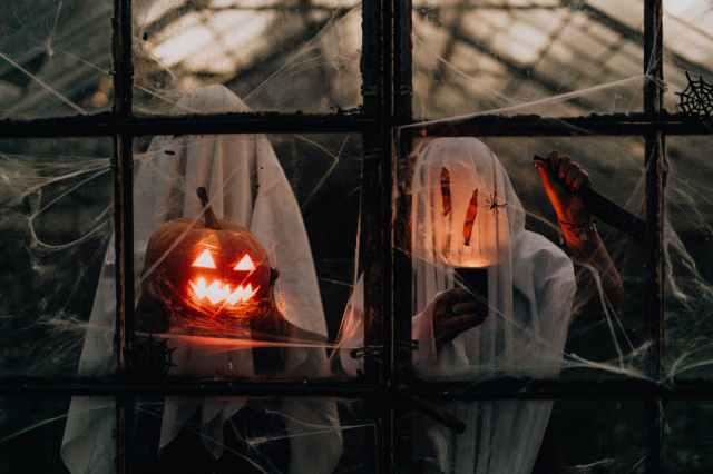 jack o lantern on glass window