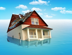 House sinking in water , housing crisis,flooding, ect. concept