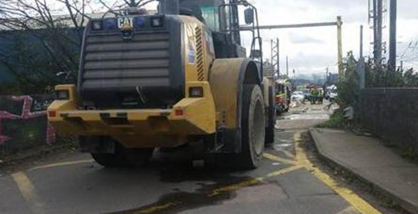 digger cripples london overhead lines