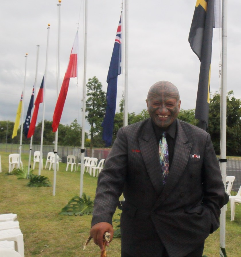 Man in front of flags