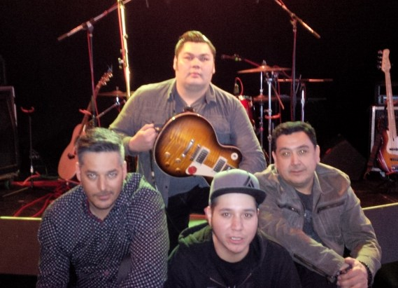(front row left to right) Adrian Sutherland, lead vocals/guitar; George Gillies, drums; Stan Louttit, bass (back row) Zach Tomatuck, lead guitar (photo by Brian Wright-McLeod)