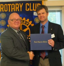 John Stewart receives his Paul Harris pin and certificate.
