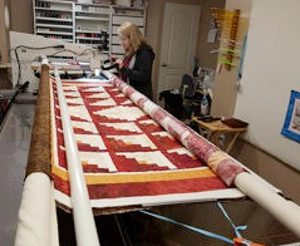 The quilt is shown on the long arm machine, nearing completion. Courtesy photo