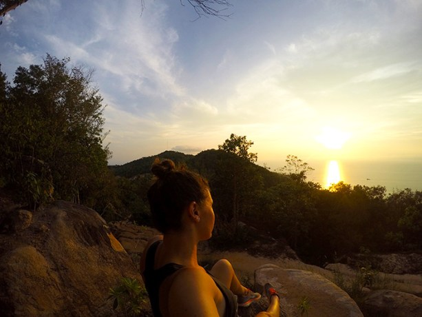 enjoying a sunset from atop a boulder in Koh Tao // Nattie on the Road