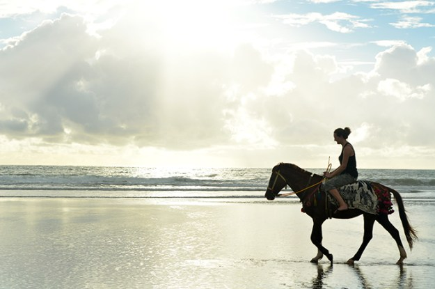 horse back riding on the beach in Myanmar