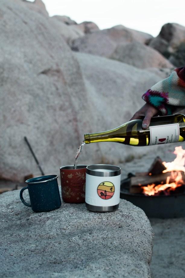 girls trip hangin around the campfire