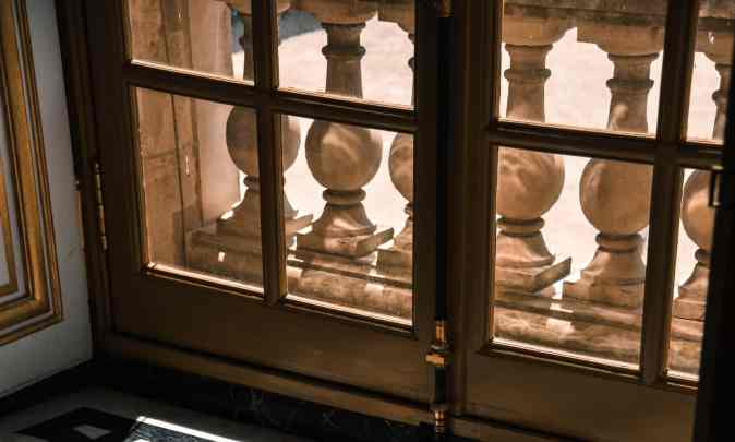 vintage balusters as railingss for balcony decor