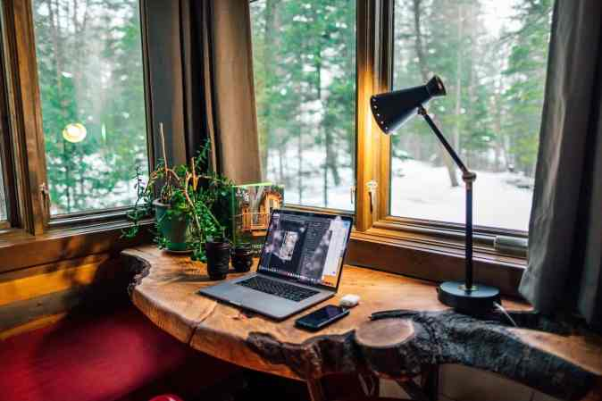 image of home office and work from home in which a slab is constructed beside a window