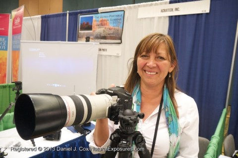 Patty Sullivan of Acratech shows off one of their ball heads at the Acratech booth during the 2013 NANPA Conference in Jacksonville, Florida