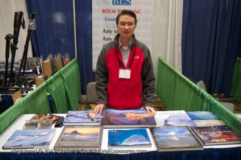 Sam Sheng shows off his products of large format photos books at the NANPA conference in Jacksonville, Florida,
