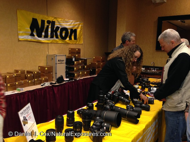 Nikon's Rose Whitaker discusses the Nikon system with folks attending the Photo Expo in Bozeman Montana.