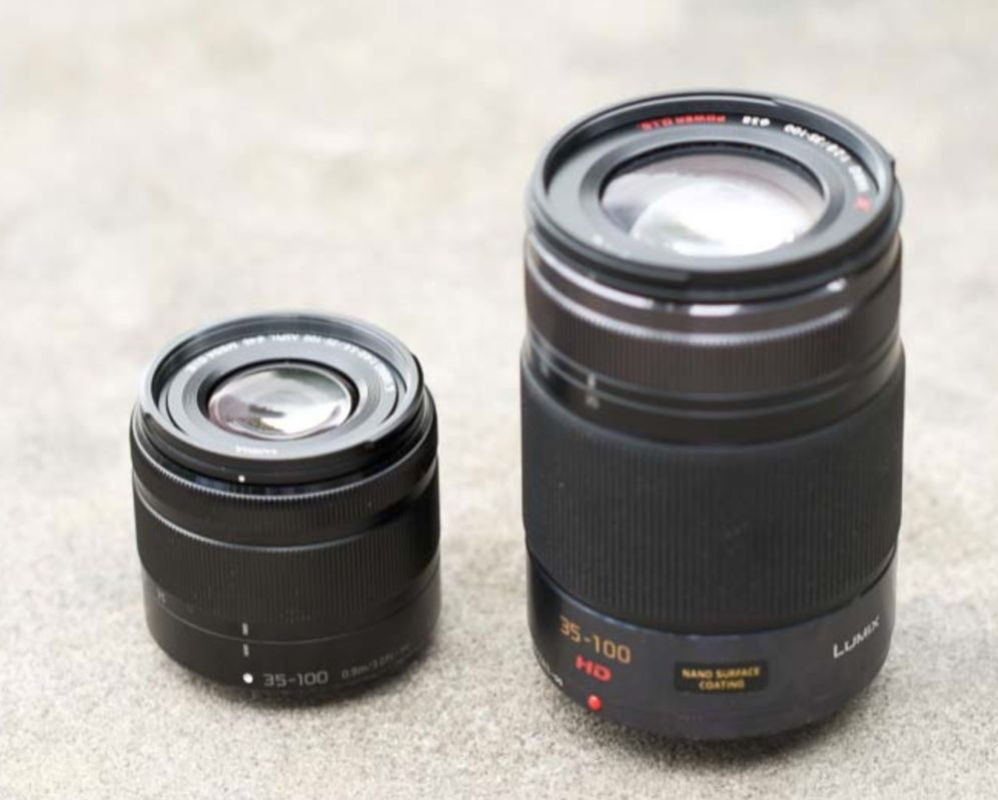 A comparison shot of the new very small Lumix 35-100mm F/4-5.6 lens with the original 35-100mm F/2.8 lens that's been round for awhile. The older 35-100mm is a professional quality optic and much faster thus the reason for it being considerably larger.