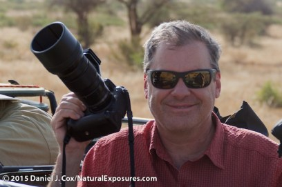Daniel Cox holding the Lumix GH4 with Olympus 40-150mm F/2.8 lens. Photo by Tanya Cox. Lumix FZ1000 125ISO