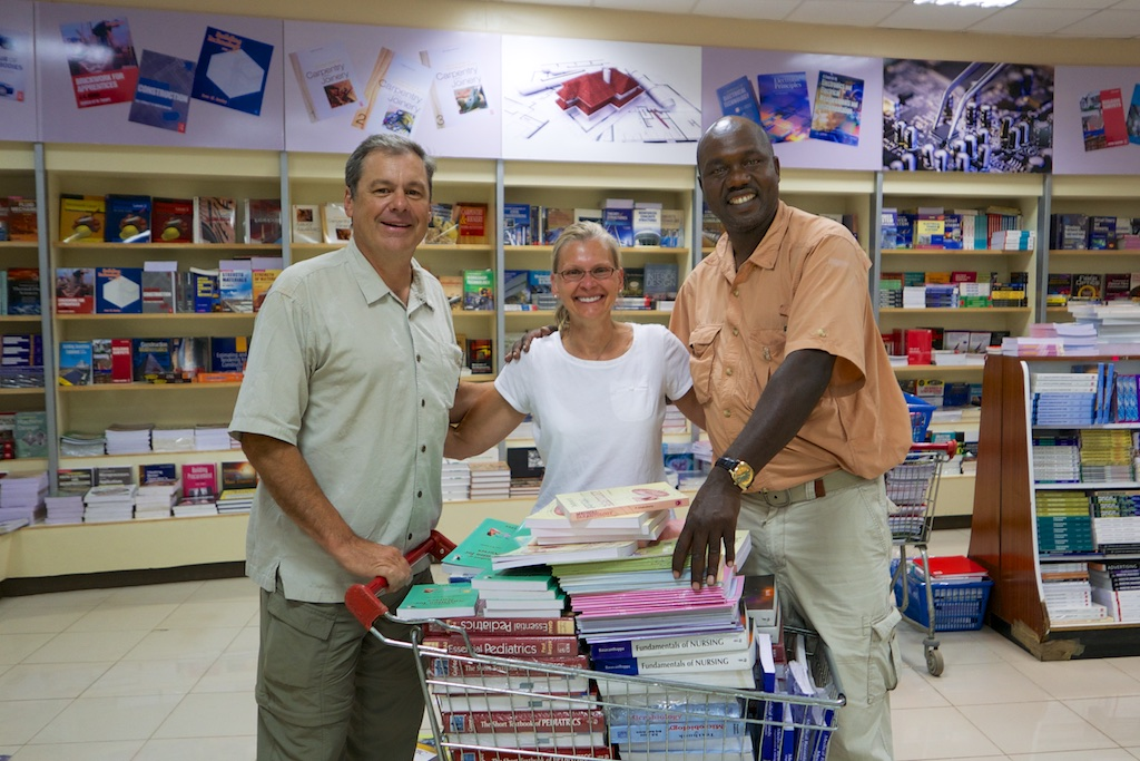 Daniel Cox, Sue Wolfe and Henry Miwani shopping for text books at the Nairobi Text Book Center, Nairobi, Kenya. Lumix LX100