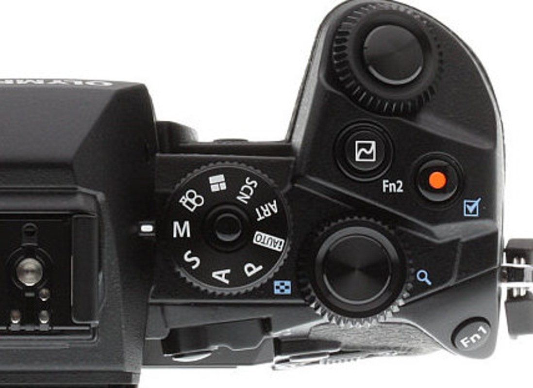 """Try what I call the """"Ease of Use"""" test. Can you figure out where the WB, ISO and +/- EV options are on this Olympus OM-D EM-1? Give you a hint, they are not on the back side of the camera."""