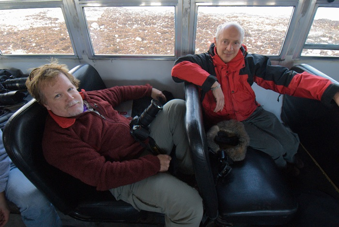 Friends for many years, Kevin Gilbert, lead Mylio Memory evangelist and Mylio's CEO and developer David Vaskevitch share dome down time on a tundra butty while photographing polar bears.