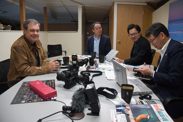 Daniel Cox discusses future lens development with Panasonic Lumix executives Henri Nishikawa, Shinji Watanabe and Yasuhide Yamada at the Natural Exposures office in Bozeman, Montana