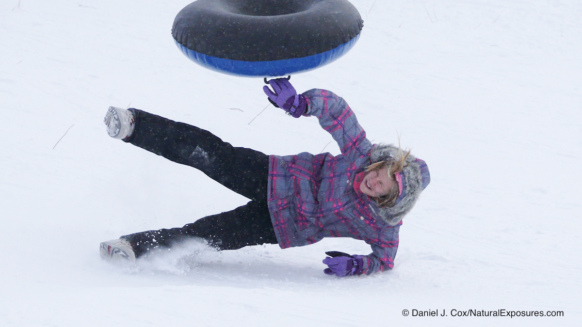 An unidentified young lady sledding on Pete's Hill. Bozeman, Montana. Lumix FZ300 in 4K photo Mode.