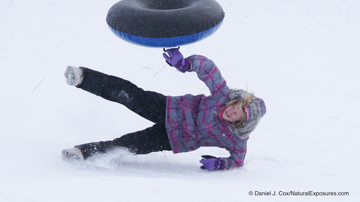 An unidentified young lady sledding on Pete's Hill. Bozeman, Montana. Lumix FZ300 in 4K photo Mode.