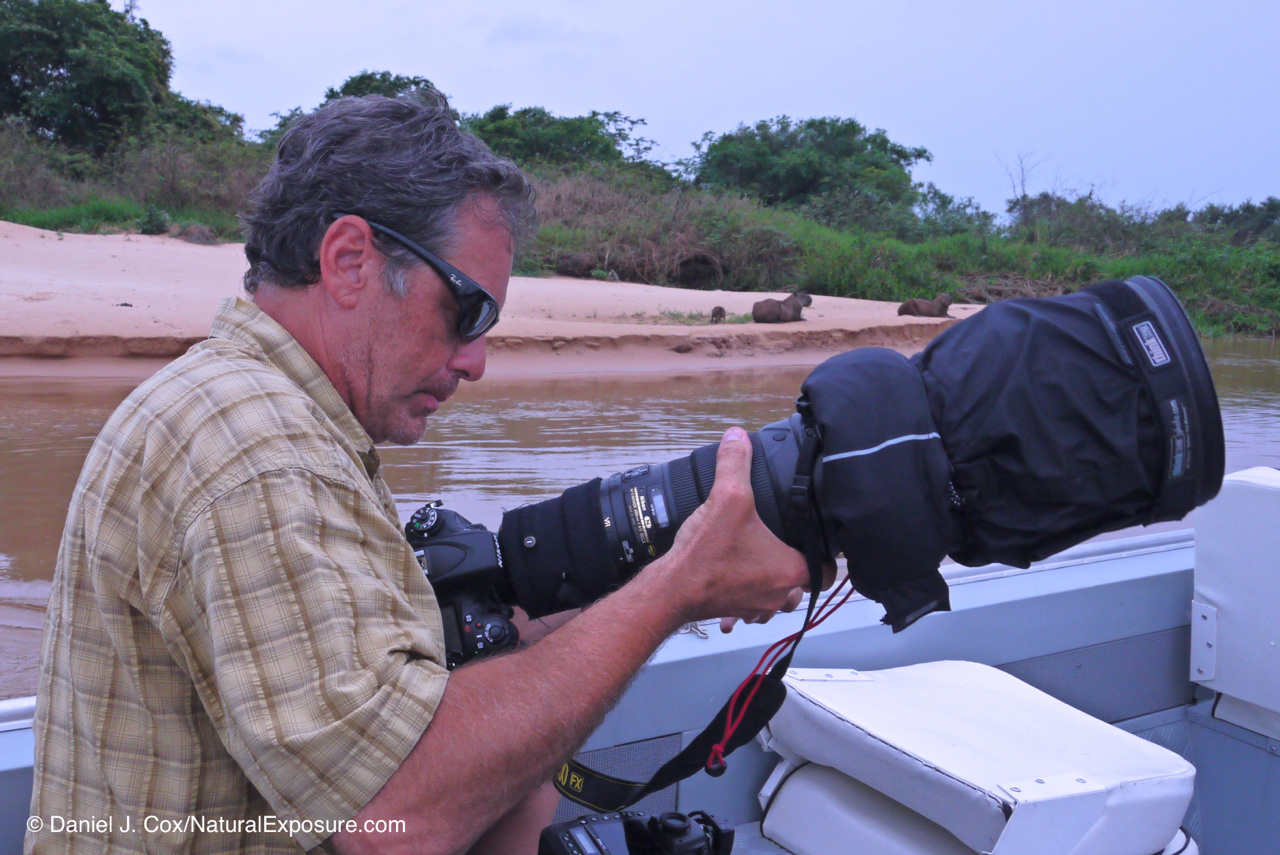 Now that's a lens. In this photo I'm working with the amazing nikkor 600mm F/4 on a river in the Pantanal of Brazil. That lens in my hands is just over ten pounds and cost almost $12,000.00US when I bought it.