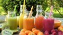 What to eat during fever and headache: Image of different delicious fruit juices.