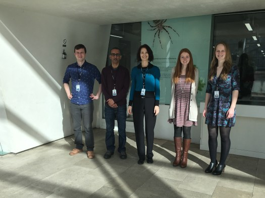 Photo showing the trainees in front of a window in the Museum's Darwin Centre