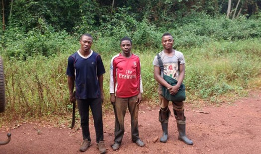 Three men on trail