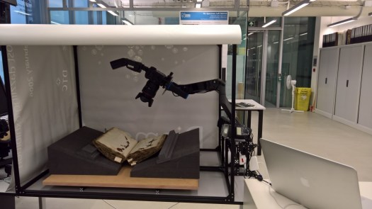 Imaging setup with the side flap of the lightbox open to show the camera support arm
