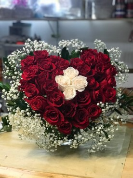 LVRE033- Heart arrangement with baby breathe, white and red roses.